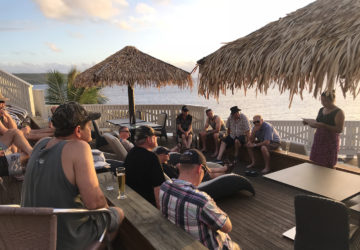 Rheem On Board in Niue group enjoying a sunset catchup