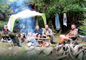 Barry Sharplin, second from left, enjoys a bit of relaxation time with friends back at camp