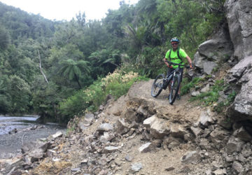 Malcolm Dawson takes a break on Motu Trails Pahiki Track.